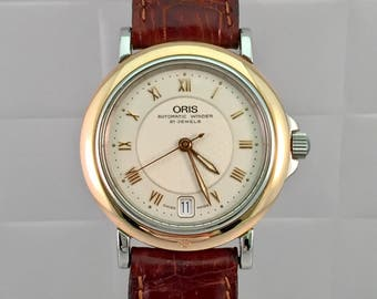 Rare clock NICOS WATCH vintage 18kt gold of 1940/50