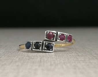 Vintage 18kt gold ring and silver chestnuts with blue sapphires and rubies