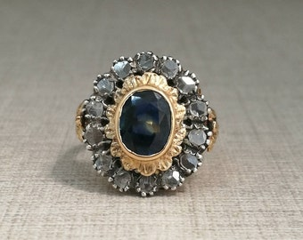 Vintage 18kt gold ring with blue sapphire and antique cut diamonds