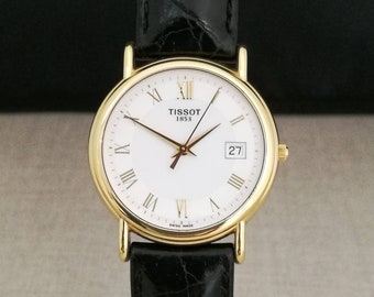 Stylish TISSOT watch in 18kt yellow gold, with boxes and documents, conditions as new.