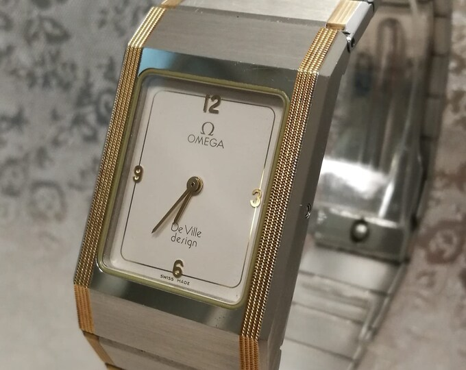 Rare OMEGA De Ville Design vintage man/unisex steel watch and gold trim. With documents