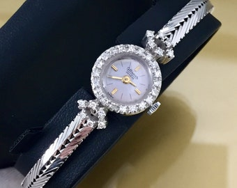 Rare and precious vintage lady ALTANUS watch in 18kt white gold and natural diamonds antique cut, manual mechanical movement.