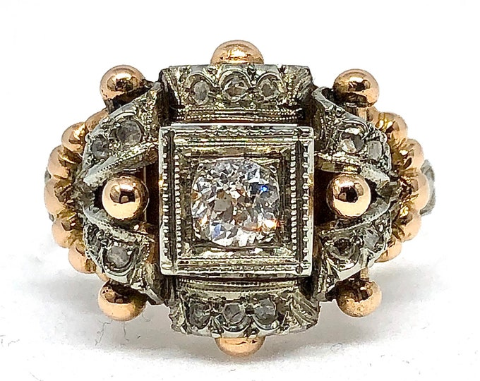 Vintage 18kt two-tone gold ring with natural diamonds