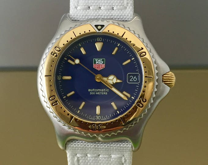 Watch TAG HEUER S/EL 200 M automatic steel and bezel 18kt vintage gold years 90