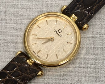 Elegant omega vintage lady watch in 18kt gold. Stock remainncy (unworn). With original documents.