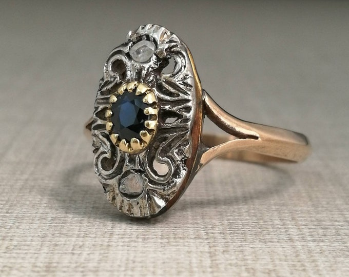 Vintage Ring in 12kt gold and silver with sapphire and natural diamonds antique cut.