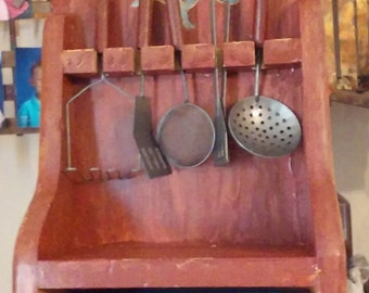 Children's utensil's with cupboard.