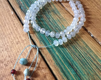 Adjustable Chalcedony bracelet hand knotted on silk with Larimar and Garnet accents