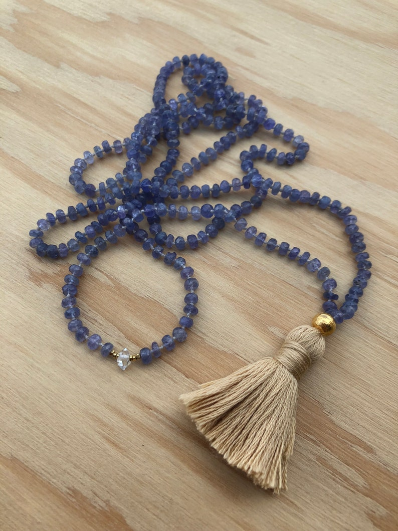 AAA faceted Tanzanite necklace featuring a single Herkimer Diamond Gold accents and tassel