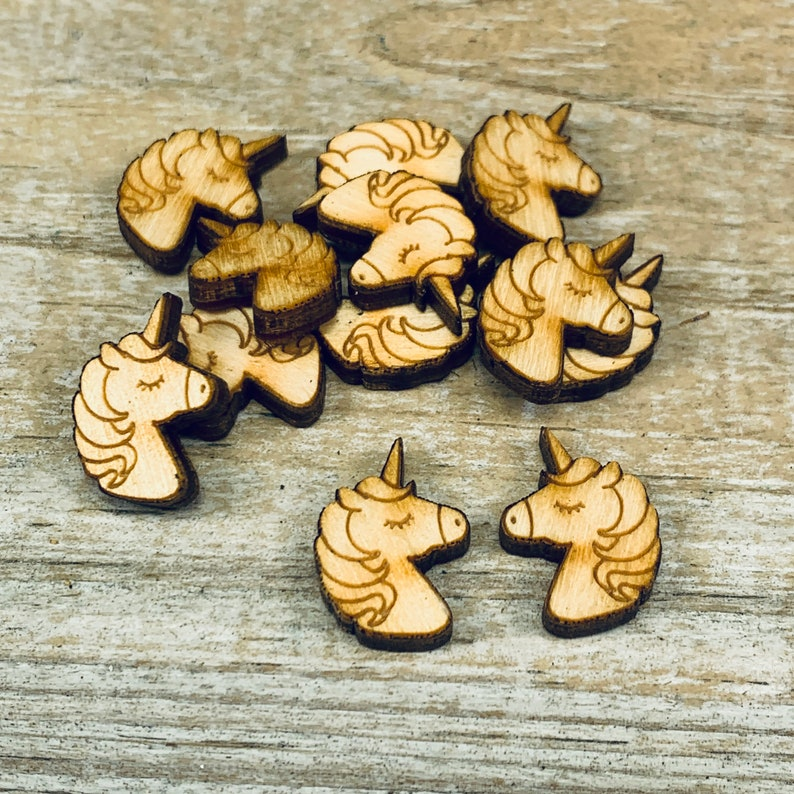 PE013 Unicorn unfinished solid hardwood engraved charms  .75 x .5  18thick