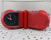 Vintage.Mid Century TimeTon Radio Alarm Clock red to flip with headphone port quartz movement used 70s.