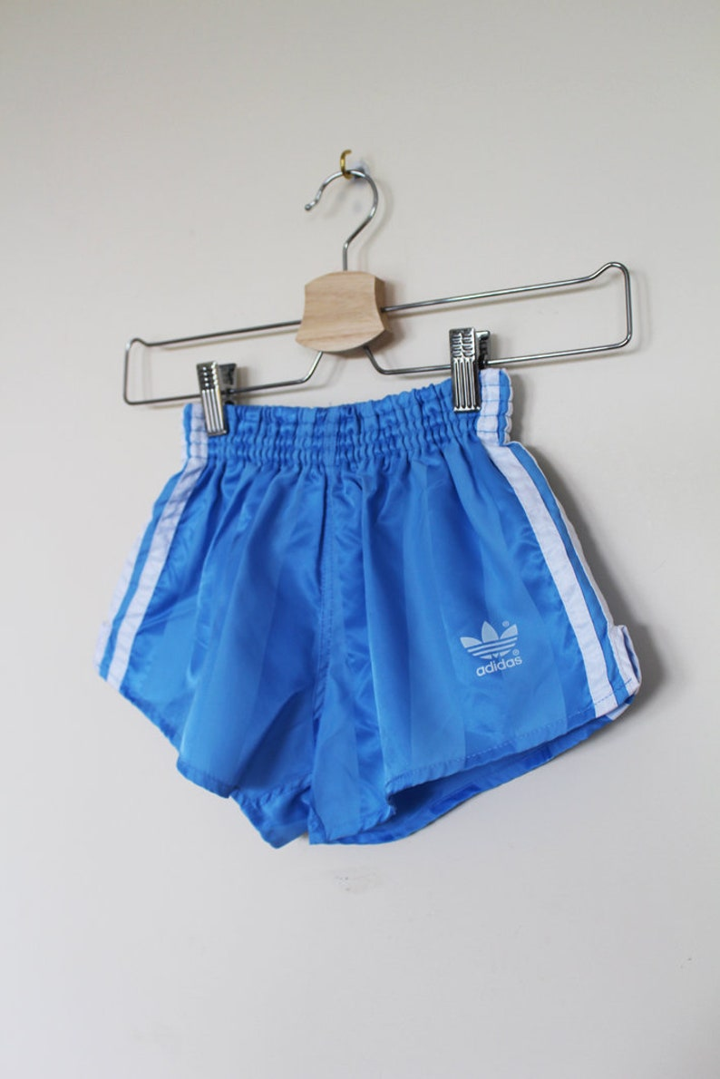 bf8ace5c9db47 KIDS // Vintage cool oldschool sporty ADIDAS originals shorts blue with  three white stripes // 1980s