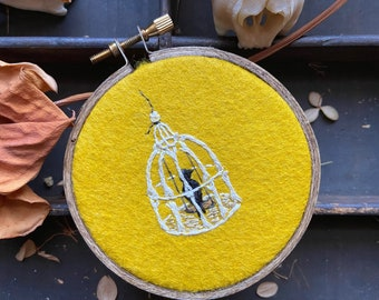Small caged bird embroidery in a 3 inch hoop