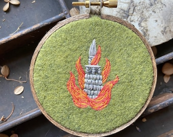 Small burning tower embroidery in a 3 inch embroidery hoop