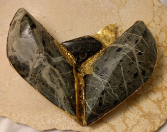 Large fossil and serpentine gold leaf winged pendant