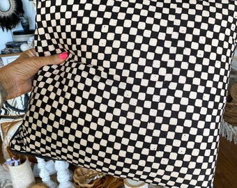 Black and white checkerboard cushion covers