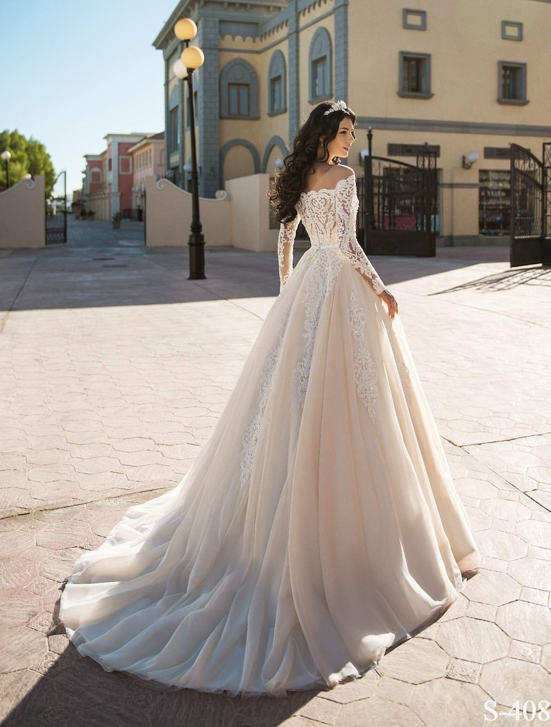 Lace wedding dress with corset an off-shoulder and long lace image 0
