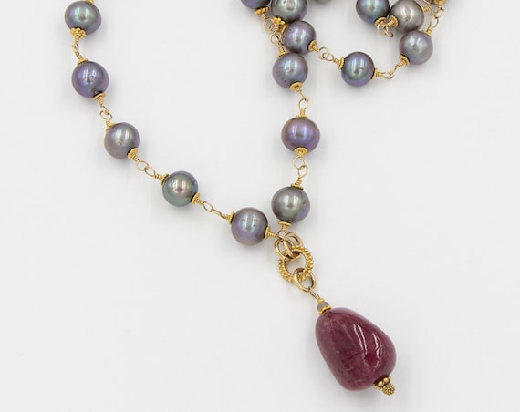 Long lavender pearl necklace with large ruby pendant
