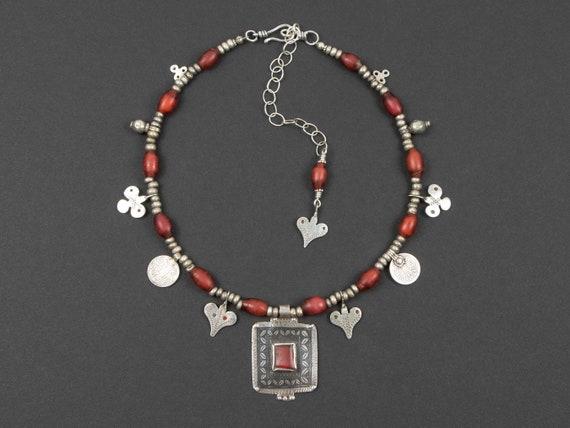 Ida Ou Nadif pendant necklace with antique red Venetian Samburu glass beads | Sahrawi amulets | niello red glass | modern ethnic jewelry