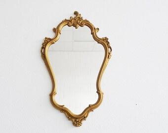 golden mirror in Baroque style , Florentine wall mirror