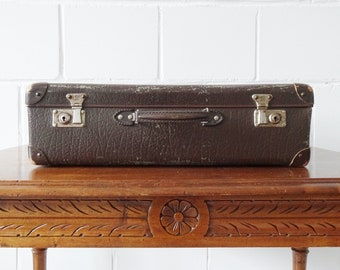 brown vintage suitcase with stickers, hard case, small suitcase