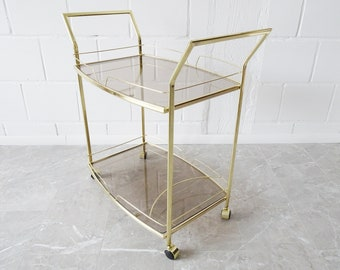 golden serving trolley with smoked glass 1980s, noble bar cart with glass floors