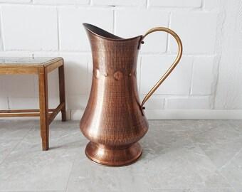 large vintage floor vase made of copper in pitcher form