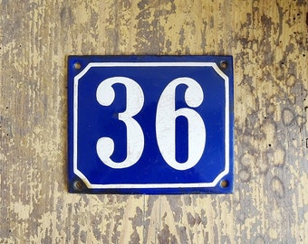 old house number plate in blue and white, enamel sign number 36