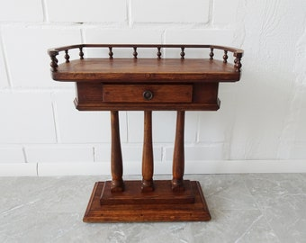 Console table made of oak wood with drawer in antique style, small column table