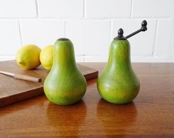 Salt and pepper mill, salt shaker and wood mill in pear form