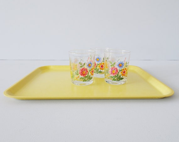 yellow tray 1970s made of poly ornamine, serving tray