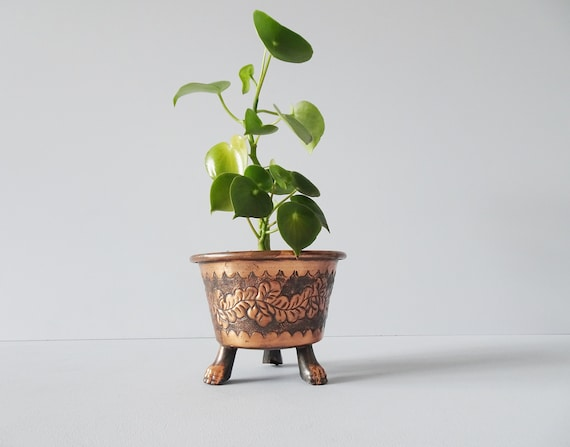 Copper plant pot with clawed foot, metal planter with relief decoration, tripod flowerpot