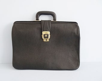 simple black briefcase in embossed leather, document bag, doctor's case