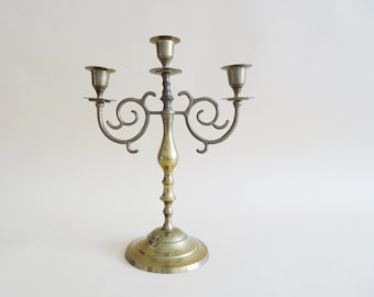 three-armed vintage brass candlestick in antique style, candlestick Mid Century
