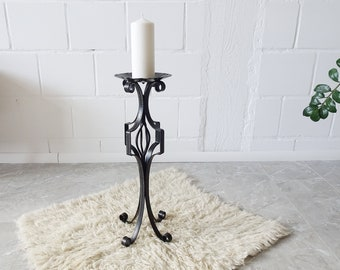 large candlestick made of wrought iron