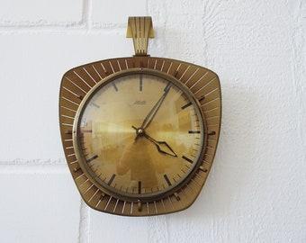 Vintage brass wall clock by Atlanta Electric