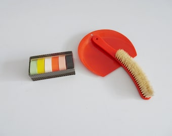 colorful table set, hand sweeper and napkin rings made of plastic