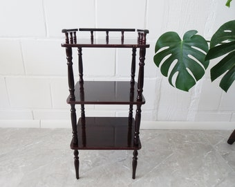 narrow console table with three wooden shelves
