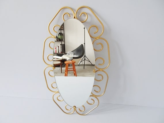 gold oval mirror, mid century gold wall mirror, gold frame mirror