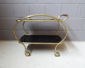 Bar cart made of brass and glass, Mid Century serving trolley with black glass shelves