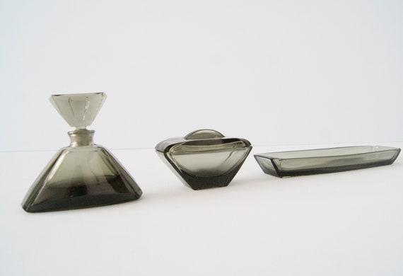 Art Deco dressing table set of smoked glass, bottle, jewelery bowl, lidded box
