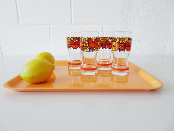 orange tray 1970s made of poly ornamine, serving tray