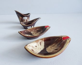four-piece vintage Jasba ceramic table set with ashtray and candle holder