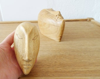 two Asian vintage wooden cans with carved face