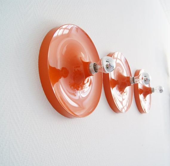 Set of three Space Age sconces, round metal wall sconce orange