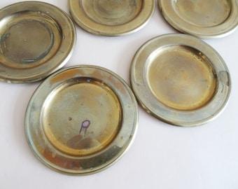 six round brass coasters