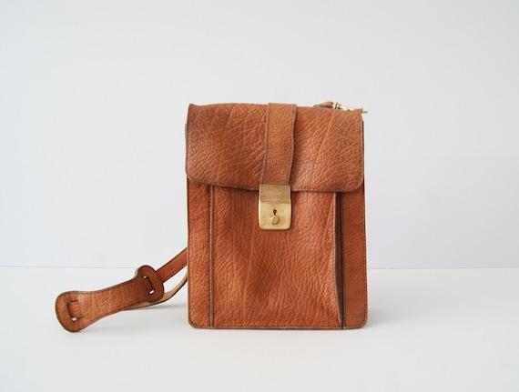 70's shoulder bag, leather handbag with brass clasp