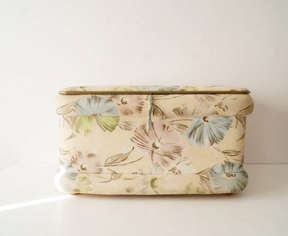 1950s laundry basket with floral pattern in pastel colors
