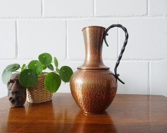 Vintage copper vase with forged iron handle