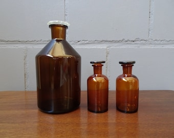 Set of three vintage apothecary bottles made of brown glass